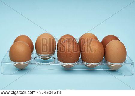 Chicken Eggs In An Egg Holder. Full Tray Of Eggs. Half An Egg, Egg Yolk, Shell. Food, Protein In Foo