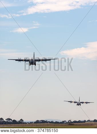 Avalon, Australia - February 27, 2015: Two Royal Australian Air Force Lockheed Martin C-130j Hercule