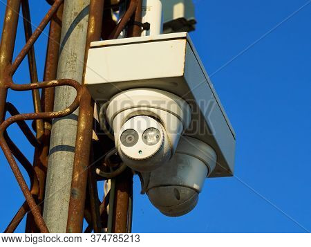 Security Surveillance Camera On A Metal Pole Big Brother Is Watching