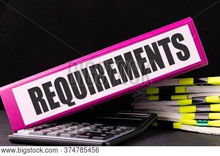 Requirements Text Is Written On A Folder Lying On A Stack Of Papers On An Office Desk. Business Conc