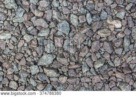 Gray Gravel Is Used In The Construction Industry. Small Road Stone Background. Granite Gravel Textur