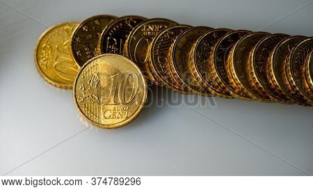 Coin Ten Euro Cents And A Stack Of Coins Lies On The Surface Of The Table. Web Banner. Business Conc