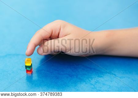 Child Playing With Mini Blocks. Interesting Game For Kids To Develop Fine Motor Skills. Education An
