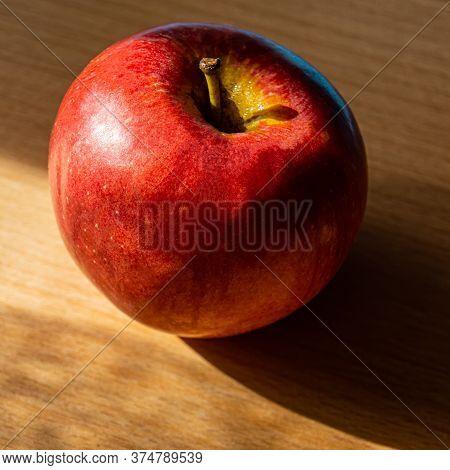 Red Apple Lies On An Oak Board. Summer Season.