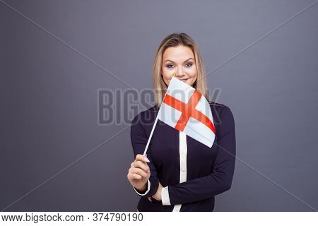 Immigration And The Study Of Foreign Languages, Concept. A Young Smiling Woman With A England Flag I