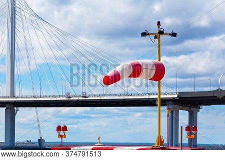 Wind Direction Indicator At A Weather Station In The Background A Cable-stayed Cable-stayed Bridge O