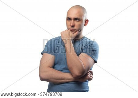 Photo Of Young Bald Puzzled Man In Blue Tee Shirt