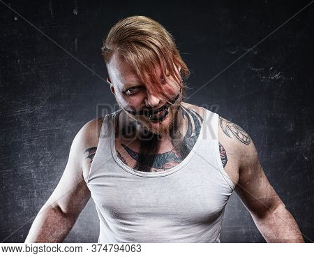 Picture Of A Tattooed Scary Mad Man With Horror Make-up