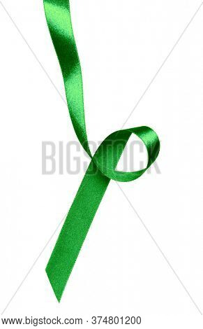 Shiny satin ribbon in green color isolated over white background. Ribbon image for decoration design.