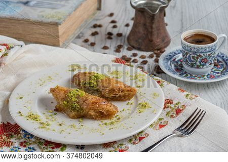 Turkish Coffee And Traditional Turkish Dessert Baklava In Plate On Wooden Table