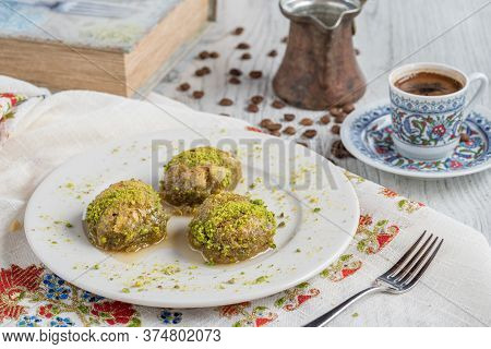 Turkish Coffee And Traditional Turkish Dessert In Plate On Wooden Table