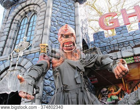 Bordeaux , Aquitaine / France - 11 19 2019 : Monster In Front Of Medieval Tower Of A Fairground Ghos