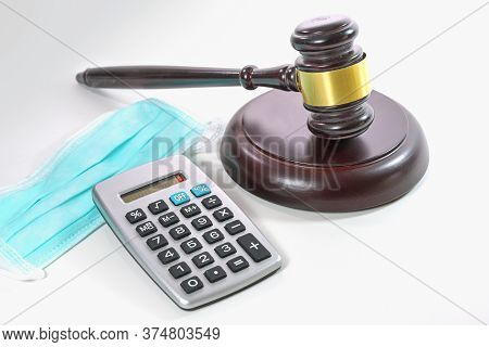 Calculator Shows Zero, Corona Face Mask And A Judge Gavel, Companies Become Insolvent During The Cor