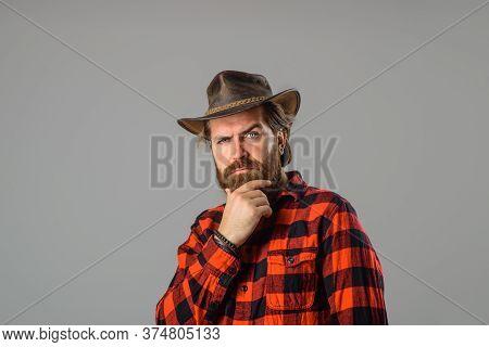 Cowboy Couture. Portrait Of Bearded Man Wearing Cowboy Hat. Western Style Men Fashion. Handsome Cowb