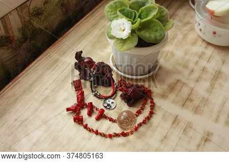 Composition Of A Crimson Horse Figurine, Red Beads Made Of Natural Coral, White Violet, A Bracelet W