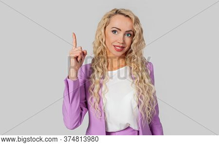 A Confident And Domineering Woman Gives Directions Pointing To The Top, Showing Number One With Her