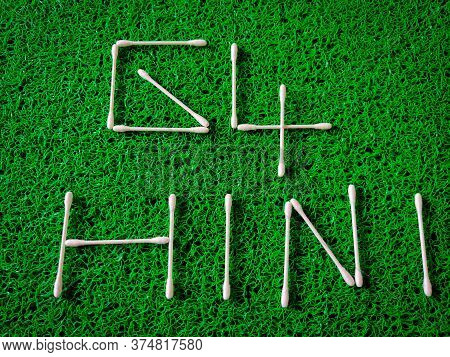 Inscription Text Of New Virus Called G4 H1n1 Made Of Cotton Ear Sticks. Isolated On Green Background