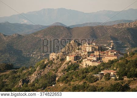 Evening Sunlight On The Ancient Mountain Village Of Speloncato In The Balagne Region Of Corsica