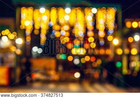 Abstract Bokeh Background. Restaurant Summer Area With Backlit. Light Bulb Garland