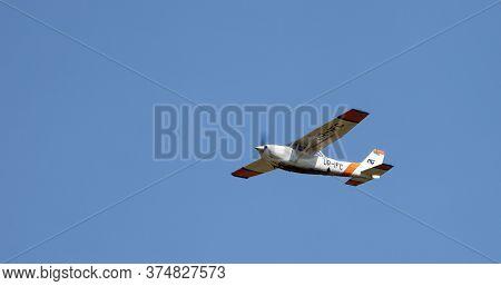 Kyiv, Ukraine - May 12, 2020: A Small Plane Flies In The Blue Sky. Aircraft Cessna 172rg Cutlass Rg,