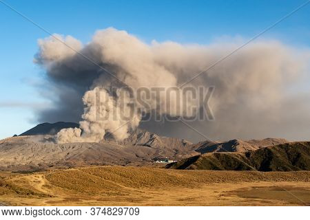 Dramatic View Mount Aso (largest Active Volcano In Japan - 1592m.) Venting Ashes Before Explosion. D
