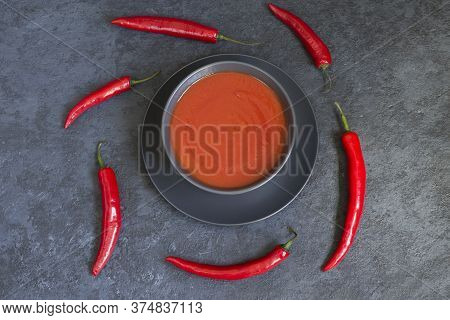 Dietary Summer Cold Gazpacho Soup Made Of Tomato In A Dark Dish, Red Pepper On A Black Background. V