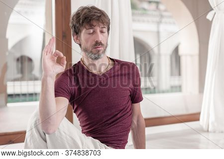 Portrait Of Bearded Man Performing Yoga In Matsyendrasana Pose - Lord Of Fish Pose. How To Keep Your