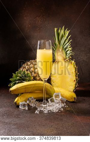 Delicious Cold Refreshing Ananas Smoothie Drink In Cocktail Glass With Banana