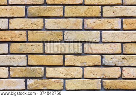 Wall Of Old Vintage Brick, Texture Of Beige Brick Wall, Protruding Brick, Neat Masonry, Close-up.