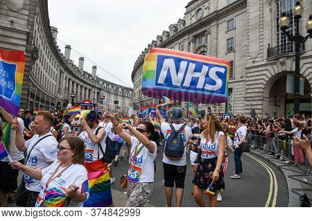London, United Kingdom, July 6 2019: Happy Pride People And Supporters Parading At The Famous Pride
