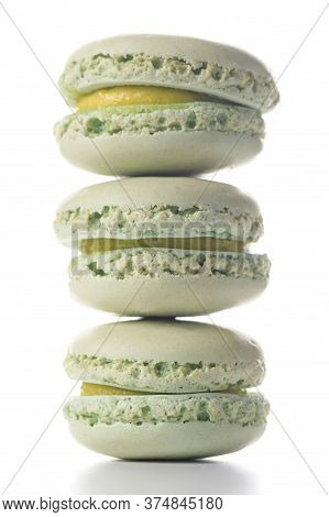 Three Mint Flavoured Macaroons Standing On Top Of Each Other On White Background.