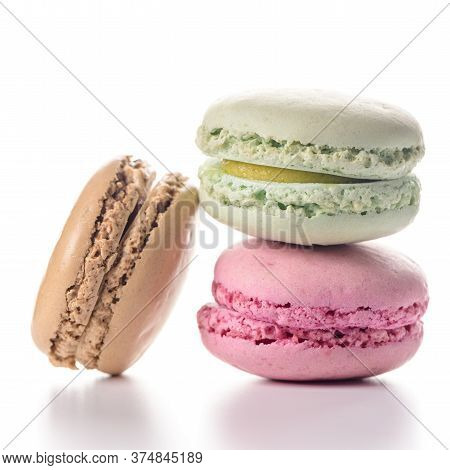 Three Delicious Macaroons Isolated On White Background.