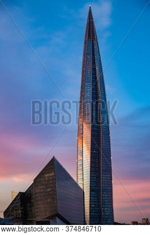Russia, St.petersburg, 03 July 2020: The Color Image Of Skyscraper Lakhta Center At Sunset, Reflecti