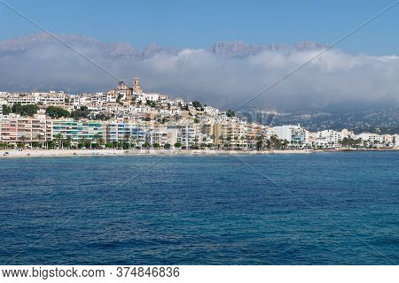 View Over The Ocean On The City Of Altea With Blue Domed Church Along Costa Blanca Coast With Cloudy