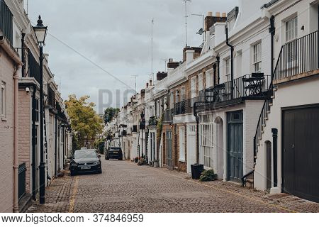 London, Uk - June 20, 2020: Rows Of Townhouses With Garages On Holland Park Mews. Houses In Mews Are