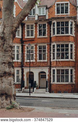 London, Uk - June 20, 2020: Facade Of Red Brick Apartment Block In Kensington, An Affluent Area Of W