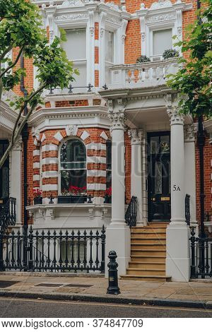 London, Uk - June 20, 2020: Exterior Of A Traditional House With Stoops In Kensington, An Affluent A
