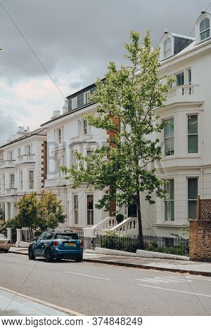 London, Uk - June 20, 2020: View Of A Quiet Residential Street With White Victorian Houses In Hollan