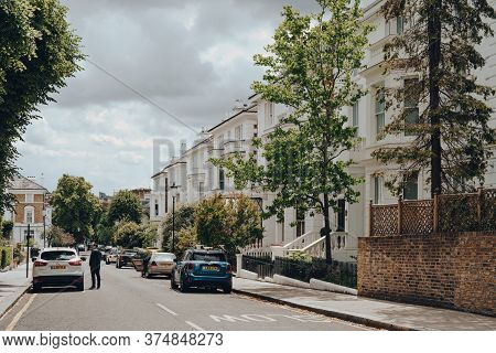 London, Uk - June 20, 2020: Cars Parked In Front Of White Victorian Houses On A Street In Holland Pa