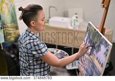 Top View Of The Girl Artist Who Paints A Picture In His Creative Studio