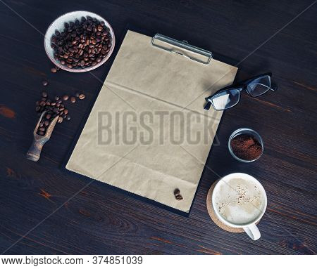 Kraft Stationery And Coffee. Clipboard With Blank Kraft Paper Letterhead, Coffee Cup, Coffee Beans,