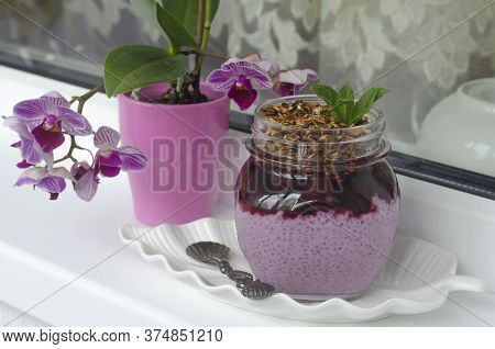 Chia Pudding With Acai Cherry And Granola