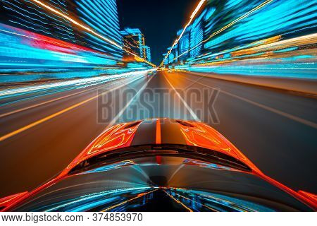 View From Roof Of The Red Muscle Car Car Moving In A Night City, Blured Road With Lights With Car On