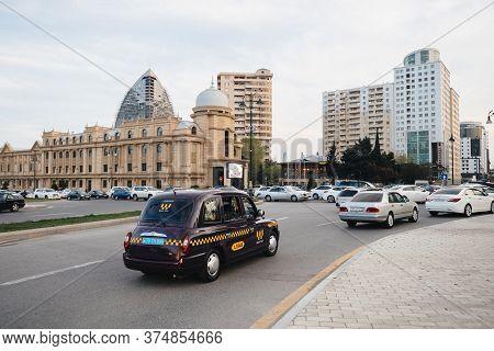 Baku, Azerbaijan - May 2, 2019: Cars Driving Fast On Central Baku Driveway With Typical Azeri Archit