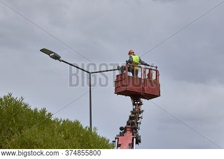 Saint Petersburg, Russia - July 11, 2019: Workers In Lift Bucket Repair Street Light Pole With Doubl