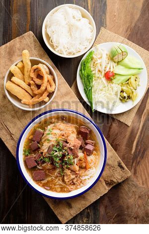Northern Thai Food (kanom Jeen Nam Ngeaw), Rice Noodles Spicy Soup With Pork And Pork Blood In Bowl