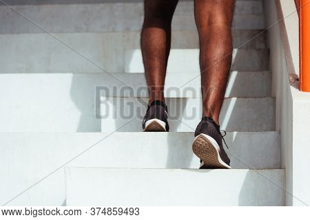 Close Up Athlete Shoes Of Legs Young Sport Runner Black Man Step Running Up To Climbing Stairs Doing