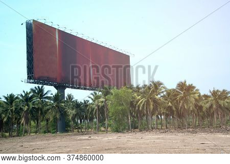Large Brown Outdoor Advertising Signs On The Side Of The Highway Or Billboard Is Blank At Noon For A