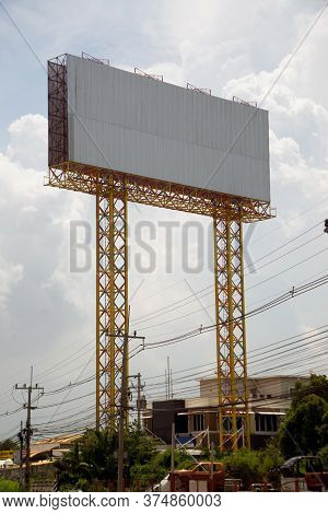 Large Gray Outdoor Advertising Signs On The Side Of The Highway Or Billboard Is Blank At Noon For Ad