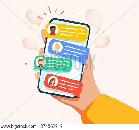 Hand Holding Phone With Short Messages, Icons And Emoticons. Chatting With Friends And Sending New M